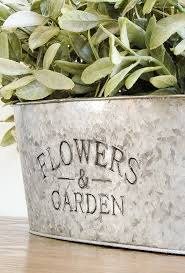 how to easily age inexpensive galvanized planters little house