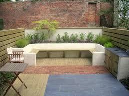 large outdoor seating rendered walls slate paving brick paving
