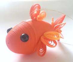 this goldfish ornament was made entirely of paper quilling