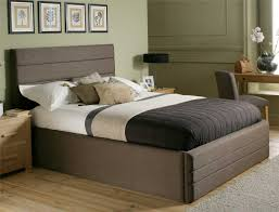 rustic western wooden bed with tree trunk headboard on laminate