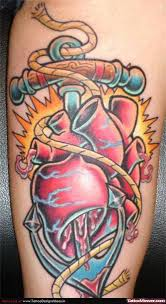 grey ink real heart tattoo on man chest tattoo viewer com