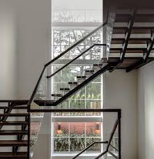 custom stair design and building in glass wood and steel