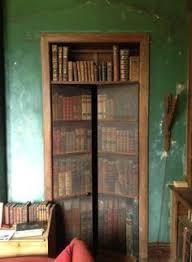 Door Bookshelves by Doors That Look Like A Book Shelf Trompe L U0027oeil By Painted Worlds