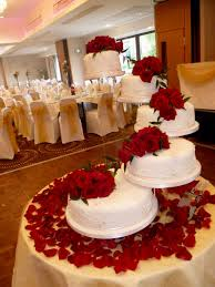 red and white wedding cakes with fountains decorating of party