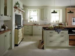 green painted island with wooden top modern country kitchens