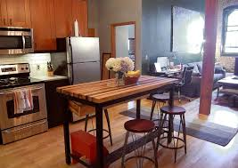 butcher block kitchen table vintage kitchen island and dining table with flower centerpieces and