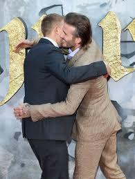 david and brooklyn beckham at king arthur london premiere