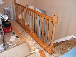 creative of installing laminate flooring around stair spindles