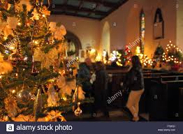 tress are decorated for a christmas tree festival inside st