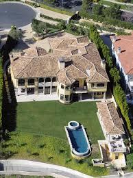 kim kardashian u0026 kanye west think their bel air home is u201cjinxed