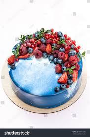 mirror glaze cake blue mirror glaze fruit cake isolated stock photo 684711259