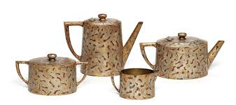 c 1144 š tea set by jean dunand 4 piece gilt bronze set late