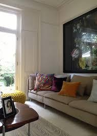 living room black sectional sofa on symmetrical design of living