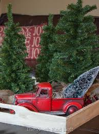 red farm truck with christmas tree the north end loft