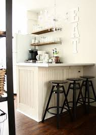 kitchen stools at breakfast bar open shelving pantry