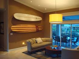 How To Decorate Apartment Walls by How To Store Surfboards Paddle Boards And Beach Cruisers