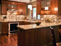 brown and stone kitchen tile with black u shaped kitchen design