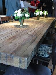 how to make a rustic table putting the planks on their ends for a diy table top would make a