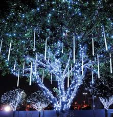 hanging lights on outdoor trees for