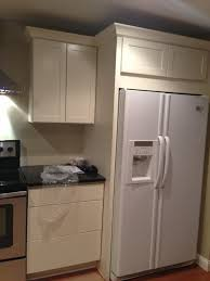gap between fridge and cabinets above refrigerator cabinet size best cabinets decoration