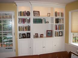 wall decoration bookshelves with doors on bottom throughout