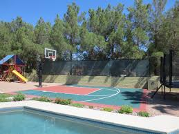 it is nice to have a swimming pool right next to the basketball