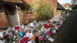 george michael fans flock to his home to leave tributes on first