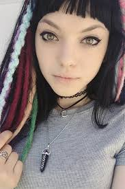 rena lovelis straight black curved bangs faux dreads hairstyle