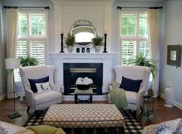 small living room ideas with fireplace the blue wall color with white trim and curtains and the wing
