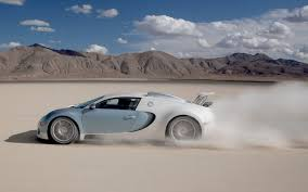 white bugatti veyron supersport white bugatti veyron super sport is racing through the desert