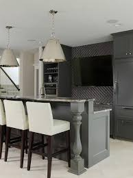 sleek basement bar features black cabinets paired with gray