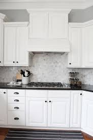 backsplash for kitchen with white cabinet almost there black countertops white cabinets and countertops