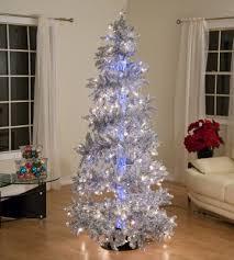 silver trees add a corresponding silver garland to echo