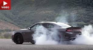 charger hellcat burnout dodge charger srt review explains the hell in hellcat carscoops