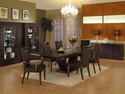 simple formal dining room with glass chandelier also framed wall