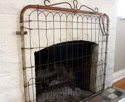 turn a gate into a fireplace screen old house restoration