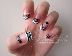 negative space black and white funky french tips in aztec tribal