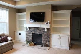 Painted Stone Fireplace Circle Entertainment Center Using White Painted Floating Shelves