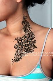 hennatattoo flower chest tattoos small rib cage tattoos