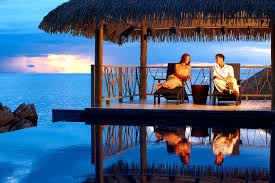 couple relaxing on a honeymoon in the bungalow over water in fiji