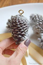make your own pine cone ornaments the joyful home