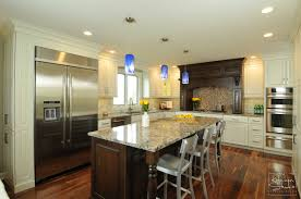 white kitchen cabinets with black island open concept kitchen in big rock the kitchen studio of glen ellyn