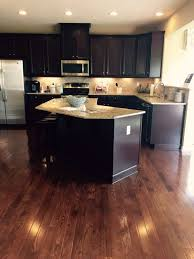 what color wood floors go with espresso cabinets homes espresso cabinets and saddle 3 1 4 hardwood