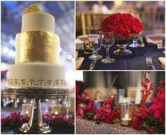 tiered wedding cake with robot topper purple and gold wedding