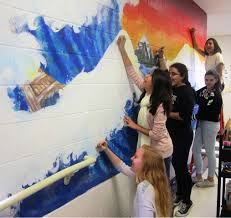 seventh eighth graders paint murals on sandwich middle school showing their artistic skills are front to back emily carlson paula ferrer