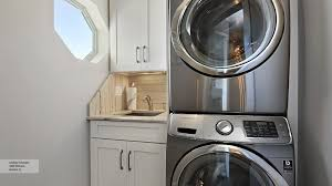 oak laundry room cabinets omega cabinetry