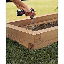 How To Install A Raised Garden Bed - garden beds using 4 by 4s with no need for corner posts hmm