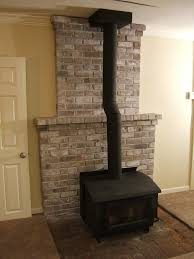 brick fireplace with chimney and the wall colors haammss