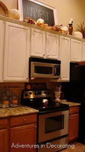 Decorating Ideas For Above Kitchen Cabinets Decor Kitchen Cabinets Decor Above Kitchen Cabinets Kitchen Design