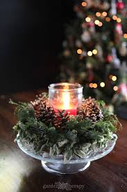 light up christmas candles gather around this diy christmas candle wreath garden therapy